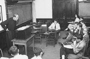 Frank L. Fadner, S.J., lecturing to students at Georgetown University