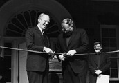 Former U.S. President Gerald Ford and Georgetown University President Timothy S. Healy, S.J., cut the ribbon at the rededication ceremony for the Old North Building