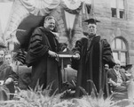 Charles W. Lyons, S.J., President of Georgetown University, presents an honorary degree to Herbert Hoover, Secretary of Commerce, at commencement