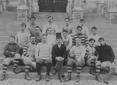 Georgetown varsity football team in front of Healy Hall