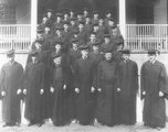 Georgetown College Class of 1920 in cap and gown, on the steps of Old North